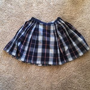 checked pleated skirt from silence + noise